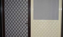 7mm Diamond Alspec security grill, Hammersley Brown, aluminium mesh. Embossed half panel & JS2, Primrose, aluminium mesh, small pet door.
