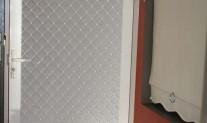 A117 Small Diamond security grill, Alspec, Pearl White, white one way mesh.