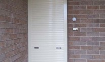 Forceshield roller shutter, spring assisted, keylock, Primrose. Envirowest front