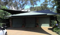 Hypar Shade Sail, Black fabric and posts. View 1