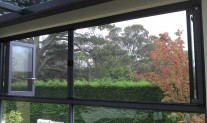 Infinity retractable Screen Double. In covered position. Ironstone frame & tracks