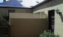 Lattice topped Dividing Wall. Aluminium & posts