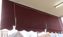 Shopfront awning rear view. Canvas Maroon C9, white J hooks & rope